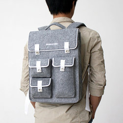 Ashen Backpack - Who says you have to give up style for space? This suave backpack was cultivated to always give you a polished look while keeping all, and we mean all, your precious valuables organized. The classic square cut and soft felt fabric make this pack a classic that's never going out of style.