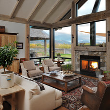 Rustic Living Room by Snake River Interiors