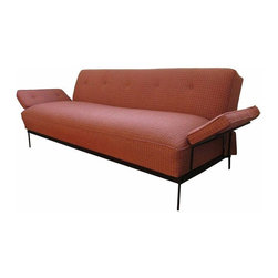 """Pre-owned Mid-Century Modern Convertible Sofa Bed - This elegant 1950s sofa features a tubular iron frame inset with tufted cushions including on the wing-like arms. When the back folds down it is 41"""" deep, creating a roomy bed for a single person. Seat height is 18""""."""