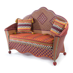 Sunset Outdoor Loveseat | MacKenzie-Childs - Exotic yet familiar, the Sunset Outdoor Collection can instantly turn any terrace or porch into a luxurious retreat. Rich golds, oranges, purples, and blues, with flashes of magenta, recall blazing summer sunsets over Cayuga Lake. Hand-woven resin wicker is as durable and comfortable as it is striking. Cushions feature a printed pastiche of patterns, quintessentially MacKenzie-Childs: checks, squiggles and dots, scallops and leaves, and bold stripes. Includes two Sunset Outdoor Throw Pillows.