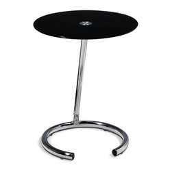 Ave Six - Angular Accent Table - Although you may no longer have a home telephone, you'll love the dramatic look of this attractive accent table, an angular piece with round tempered glass top and a chrome colored steel base. The table is from the Avenue Six Telephone collection, and would be an ideal accent as part of your bedroom, hall or living room decor. Chrome and Black Glass finishes. Durable chromed steel base. Tempered Glass top with polished edge. Some assembly required. 16 in. W x 16 in. D x 19.5 in. H
