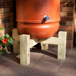 Hamptons Rain Barrel Stand - Give your rain barrel a lift with the Hamptons Rain Barrel Stand. Constructed of select grade pressure-treated Southern pine this stand is built tough and can support a full rain barrel. Your rain barrel will be lifted 11-inches off the ground. You'll be surprised how much 11-inches helps when it comes to filling a watering can and saving your back from all that bending. Comes in your choice of finish. The Hamptons Rain Barrel Stand is designed for use with the Great American Rain Barrel Spruce Creek Rain Wizard 50 Big Blue Algreen Aqua Algreen Cascata and the Rain Barrel Company Californian.