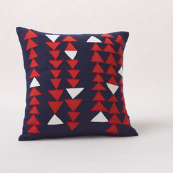 Triangle Row Pillow - Appliquéd with chains of cotton triangles, our linen pillow echoes both traditional quilts and modern art. The cover closes at the back with coconut shell buttons. Removable kapok insert included.