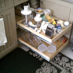 Kitchen Pull Out Shelves - ShelfGenie of West Palm Beach's blind corner cabinet solution helps you utilize your corner cabinet space efficiently.  Extend the front shelf, then slide the shelf over from the corner to easily access those items.