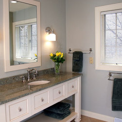 Spa-Like Bathroom Remodel - The custom, freestanding-style vanity has deep drawers for the homeowner to store toiletries  and other products.Photo Credit: Erol Reyal