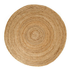 Anji Jute Kerala Round Rugs - Natural - 6' x 6' - Our beautiful Kerala Round Natural Rugs will complement any room. The subtle textures and hand-woven patterns of our jute rugs complement a wide variety of décor styles. Jute is an incredibly versatile and sustainable natural fiber, and is harvested from crops that actually enrich the soil and support small, traditional farms. Jute manufacture produces minimal waste and emissions, and the long, soft and durable fibers can be woven into a variety of beautiful products, like these stunning, and sustainable, rugs. Care: Vacuum regularly without beater, spot clean with a damp cloth. Blot any spills with a clean, dry cloth. Dimensions: 6' x 6'.