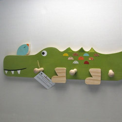 Alligator and Little Bird Peg Rack by Maple Shade Kids - Hang up kids' coats, scarves and more with this friendly, wooden Alligator and Little Bird Peg Rack. I appreciate that the wood is cut using eco-friendly, Forest Stewardship Council (FSC)–certified poplar wood, and it was decorated using non-toxic paints and glues.