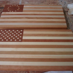 """AMERICAN FLAG CUTTING BOARDS! - This is a great project! Sprague Woodworking will make our famous American Flag cutting boards from time to time upon request. We usually make them for local charity fundraisers and donate them to our favorite local  organizations. The stripes are made of maple and cherry, the star backround is mahogany and the stars are basswood 3/8"""" plugs. The board measures approximately 18"""" x  12"""" . Glenn Pafford"""