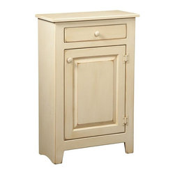 Chelsea Home - Chelsea Home Hannah Small Kitchen Cabinet - 465-007 - Shop for Pantries from Hayneedle.com! Don't sweat the small stuff - stash it in the Chelsea Home Hannah Small Kitchen Cabinet. Crafted with durable solid Eastern white pine wood finished in pale buttermilk stain this piece gets antique-country flair from heavy distressing. The simply carved door opens to cabinet space with an adjustable shelf for dishes linens glassware books and papers and more. At the top a slim drawer can catch silverware and napkins or pens and note paper. Painted round wooden knobs are an understated finish.About Chelsea Home FurnitureProviding home elegance in upholstery products such as recliners stationary upholstery leather and accent furniture including chairs chaises and benches is the most important part of Chelsea Home Furniture's operations. Bringing high quality classic and traditional designs that remain fresh for generations to customers' homes is no burden but a love for hospitality and home beauty. The majority of Chelsea Home Furniture's products are made in the USA while all are sought after throughout the industry and will remain a staple in home furnishings.