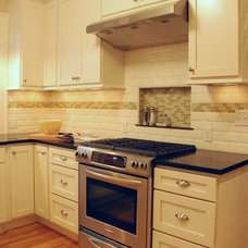 Traditional Kitchen Traditional kitchen featuring cream painted shaker cabinetry