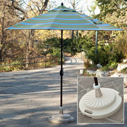 Patio Living Concepts - 95 lb. Commercial Grade Patio Umbrella Stand - 00290 - Shop for Lamps from Hayneedle.com! The simple solution to supporting umbrellas up to 9-ft depending on the usage the 95 lb. Commercial Grade Patio Umbrella Stand can be made heavy enough to hold anything down. This stand arrives to you hollow and lightweight so you're not paying to ship a heavy stand. Once you have it you can fill it with up to 95 lbs. of sand making it incredibly heavy and sure to stay put. Constructed of plastic this stand is completely weatherproof and will not rust. It's available in several color options so there's sure to be one that matches your patio furniture. The neck will accommodate umbrella poles from 1.5- to 2-inches diameter and a locking screw-on cap holds the sand inside. Smooth gliding rollers make it easy to move even after it's been filled. Designed for use with umbrellas up to 7.5 feet free standing and 9 feet in conjunction with a patio table. Not designed for freestanding umbrellas 9-foot or larger. To reach a 95 lb. weight pour sand slowly and shake to ensure the base is filled to full capacity. Additional features Commercial quality stand Locking screw-on cap keeps sand inside Smooth glide rollers for easy moving Works with umbrella poles 1.5- to 2-inches diameter Measures 22L x 22W x 12H inches