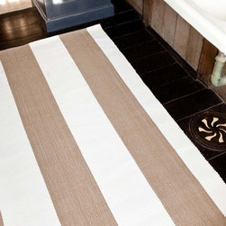Lakehouse Khaki/White Indoor/Outdoor Rug - Cover your floors in a style that makes equal allusion to the beach house and the garden orangery.  The Lakehouse Indoor/Outdoor Rug in Khaki and White offers elegance as well as durability with wide French stripes that, unusually, run the length of the rug, making it perfect to visually expand your space.  Its neutral hues provide simple versatility and classic implications.