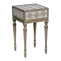 Ambella Home - Regalia Accent Table - Chess anyone? You will feel the urge to pull out the chessboard when you get a glimpse of this accent table. Delicate carved legs are finished in a gold and silver wash that complements the aluminum checkered inlay. One drawer will keep your knights, queens and kings in their places.