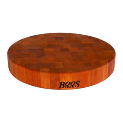 John Boos - John Boos Round End Grain Cherry Cutting Board Multicolor - CHY-CCB15-R - Shop for Cutting Boards from Hayneedle.com! Because of it's rich color tight grain and dense durable body cherry has long been used in furniture making and trim carpentry so it's no surprise to see it show up on your countertops in the form of the John Boos Round End Grain Cherry Cutting Board. This stunning wood takes advantage of an end-grain design to show off it's natural beauty and toughness. The thick body is finished with beeswax for a food-safe and elegant style. Available in your choice of size.About John Boos ProductsLocated in Effingham Ill. John Boos has become world-renowned for their high-quality kitchen products. Not only is John Boos proud to be featured by numerous celebrity chefs on Food Network programs and others but they also keep an eye on their environmental footprint. Protecting the environment is an integral part of John Boos' business practice. They're firmly committed to using sustainable resources recycling byproducts and maintaining healthy air quality as they manufacture their products. John Boos has been awarded the Gold Medal for Excellence in Foodservice Equipment by the Chefs of America a prestigious acknowledgement of their commitment to quality.