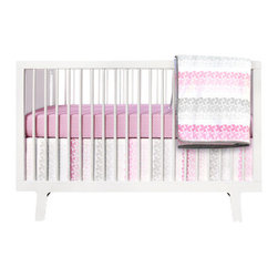 Olli and Lime - Pinwheel 3-piece Crib Bedding Set, Pink and Gray - Pink is perfect for baby girls, but it really pops when it's contrasted with a cooler color. The gray makes this feel more modern and sophisticated, while the pattern adds a playful touch.