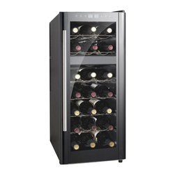 SPT Appliance - 21-Bottle Dual-Zone Thermo-Electric Wine Cool - ETL certified. Freestanding application. Front leveling leg. Light soft interior. Thermo electric cooling system. Six slide-out shelves. Quiet operation. Environment friendly. Double pane insulated glass door. Black cabinet with platinum trim. Digital controls with LED temperature display. Capacity: 21 bottles / 65 liters. Input voltage : 110V / 60Hz. Current: 1A (77�F). Input power: 140W. Protection class: I. Climate class: SN:N. Power consumption: 0.55kWH/24hr (59�F). Color: Black. Temperature range : 45 ~ 64�F/51 ~ 64�F. Max working temperature : 89�F. Maximum temperature variance: 35�F between ambient and unit. 20.28 in. W x 13.58 in. D x 31.7 in. H (43 lbs.)Equipped with newest ThermoElectric heating technology, should the ambient temperature fall below set temperature, unit will heat to maintain your set temperature. 8 standard bottles capacity with 1 removable shelf. Double pane insulated glass door with platinum trim. Stylish design and compact size looks great in the kitchen or entertainment area. Simple to use digital controls with LED display. ThermoElectric Technology (no compressor) offers a quiet operation with no vibration. Adjustable temperature between 45 to 64�F.