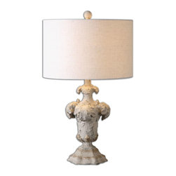 Uttermost - Cassano Antique Ivory Table Lamp - Distressed antiqued ivory finish with dark bronze undertones and gold highlights. The round hardback drum shade is a beige linen fabric with natural subbing.
