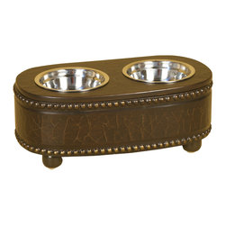 Welcome Home Accents - Pet Feeder - Keep your pet's food and water easily accessible without sacrificing your decor with this brown faux leather double bowl brown pet feeder. The raised feeder keeps your pet's bowls off of the floor and slightly elevated to ease digestion. With metal studding on the faux brown leather surface  and two silver metal bowls. Bowls are removable for easy cleaning and filling