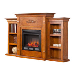 Holly & Martin - Fredricksburg Electric Fireplace with Bookcas - Provides storage and functionality, perfect for any room. Beautiful media room accent. Features 6 shelves. Max weight capacity: 85lbs (mantel). Accommodates up to a 42 in. flat panel TV. Constructed of pine, MDF, and pine veneer. Glazed pine finish. Assembly required. Features realistic flickering flames and burning embers using long life LED lights. Remote control operated (1 CR2025 battery included). Easy to use controls for adjustable thermostat, with timer. Adjust flame and ember brightness separately for the perfect fire. Plugs into standard wall outlet with 6 ft. cord. Tested to heat 1500 cubic feet in only 24 minutes (14 ft. x 14 ft. x 8 ft.). 120V-60Hz, 1500W / 5000 BTUs, 12.5 Amps. Safety thermal overload protector. No combustion, glass remains cool to the touch. 100% energy efficient and uses about as much energy as a coffee maker, offering low operating costs. Eco friendly, consumes no wood or fossil fuels and produces zero emissions or pollutants. 70.25 in. W x 14 in. D x 42.25 in. H. Shelves: 12 in. W x 7.5 in. D x 8.5 in. H. Firebox front: 23 in. W x 20 in. H If you are looking for an elegant accessory for your home, this electric fireplace is perfect for you. This beautiful and functional electric fireplace features a glazed pine finish that looks great in any room. A classic floral design is carved across the top of this fireplace, above the firebox. Three bookcase shelves on either side of the firebox provide space and storage for all of your favorite readings, media and home decor accessories. Requiring no electrician or contractor for installation allows instant remodeling without the usual mess or expense. In addition to your living room or bedroom, try placing this fireplace in your home office. Use this great functional fireplace to make your home a more welcoming environment.