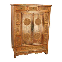 Antique Chinese Cabinet with Ornate Carvings - An exceptional Antique Chinese Cabinet Wardrobe Armoire Chest dating to 1880 in elm from the Henan Province, featuring ornate carvings of flowers and geometric designs. The overall condition is restored. It shows normal wear to the finish and miscellaneous nicks, dings, and scratches due to age and use. There is wood separation on the front doors and on the top at the joints. A small piece of trim on the left side bottom skirt has been replaced. The piece has been clear coat refinished, but maintains faint traces of its original lacquer finish.