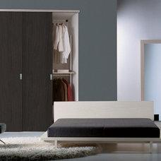 Contemporary Closet by Cronos Design