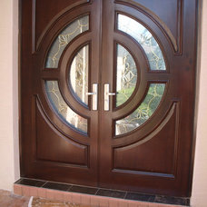 Contemporary Front Doors by Carril designs LLC
