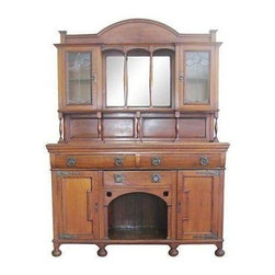 Pre-owned Antique Arts & Crafts Cabinet - 2 Pcs - A gorgeous Arts and Crafts cabinet from the early 1800s. The expert workmanship from the hand-hewn planks, dovetails and leaded glass doors to the iron hardware make this cabinet extraordinary. The piece is in excellent antique condition.