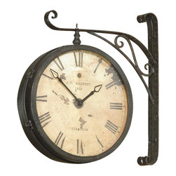 Bassett Mirror - Wall Mount Hanging Clock w Roman Numerals in - Double-faced. Round clock. Antique-look design. Decorative piece. 20 in. L x 25 in. H (29 lbs.)
