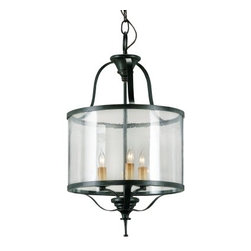 Ardmore Lantern - I love the curve of this lantern. The round glass almost makes it feel like it has a clear drum shade.  It would be perfect in the center of a casual living room.