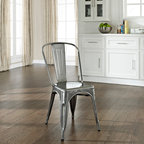 "Crosley Furniture - Amelia Metal Cafe Chair in Galvanized Finish - Includes (2) Chairs. Sturdy Steel Construction. Easy To Assemble. UV Resistant. Stackable. . Galvanized finish is hand-prepared, and will rust over time for an authentic vintage appearance.. 17 in. W x 21 in. D x 34 in. HOriginally made famous in the quaint bistros of France, these midcentury replicas of original caf̩ seating will offer a dose of nostalgia combined with careful consideration for your wallet.  This inspired revival evokes a sense of a true vintage find. The Amelia collection is available in a variety of colors, including our unique galvanized finish. This raw steel look is hand prepared to enhance the inherent tones of the metal. Designed to acquire an aged patina, the galvanized finish will naturally rust over time, giving it a unique industrial ""relic"" look."