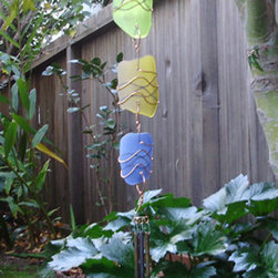 Sun Catcher Chime - This wind chime is art and music at the same time. The art glass comes in several colors and is really striking along the body of the piece. The chimes are made of brass so they will have a beautiful sound.
