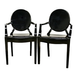 Wholesale Interiors - Dymas Modern Acrylic Black Armed Ghost Chair - These otherworldly black accent or dining chairs are simultaneously formal, modern, classic, and lightweight. Each chair is a sturdy acrylic and is conveniently stackable. Included on each foot is a plastic non-marking foot in black to match the legs and frame of the chair. This design is also available without armrest.