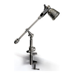Go Home - Go Home Leighton Drafter Lamp - This Leighton Drafter Lamp is suitable to any home and office settings. It is constructed of brass as the basic material with Industrial Steel finish to provide it the exact look. The robotic arms are adjustable to an appropriate height according to your need.