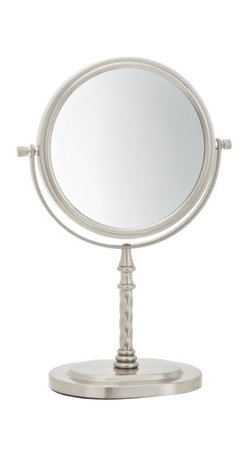Jerdon JP526N 6-Inch Tabletop Two-Sided Swivel Vanity Mirror with 5x Mag - The Jerdon JP526N 6-Inch Tabletop Two-Sided Swivel Vanity Mirror is an ideal bathroom and makeup accessory that provides magnification options to display a clean reflection whenever you need it. This two-sided circular mirror has a 6-inch diameter and features a smooth 360-degree swivel design that provides 1x and 5x magnification options to make sure every detail of your hair and makeup are in place. The JP526N stands 11-inches high, stands upright on countertops, vanities and tables and has an attractive matte nickel finish that protects against moisture and condensation. The Jerdon JP526N 6-Inch Two-Sided Tabletop Vanity Mirror comes with a 1-year limited warranty that protects against any defects due to faulty material or workmanship. The Jerdon Style company has earned a reputation for excellence in the beauty industry with its broad range of quality cosmetic mirrors (including vanity, lighted and wall mount mirrors), hair dryers and other styling appliances. Since 1977, the Jerdon brand has been a leading provider to the finest homes, hotels, resorts, cruise ships and spas worldwide. The company continues to build its position in the market by both improving its existing line with the latest technology, developing new products and expanding its offerings to meet the growing needs of its customers.