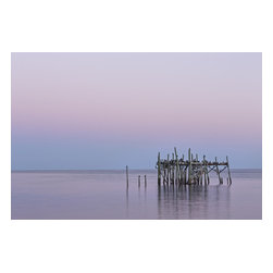 "Barely Standing, Limited Edition, Photograph - ""This photograph was taken in Cedar Key, Florida. The weather systems are slowly breaking down the structure while the cloudless sky   This photograph measures 60x42 and includes the choice of a brown or black wood frame. In addition, the photograph is varnished for protection instead of using glass, acrylic or a mat. Glass or acrylic produces reflections, thereby diminishing the quality of the image. All photographs are signed, numbered in a limited edition of 9 total artist proofs, and come with a Certificate of Authenticity. """
