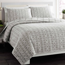 City Scene - City Scene Puzzle Grey Reversible 3-piece Cotton Quilt Set - A white geometric puzzle pattern is displayed across a soft grey ground to bring contemporary style to this reversible quilt set. Crafted with comfortable cotton,this machine washable bedding comes with matching shams.