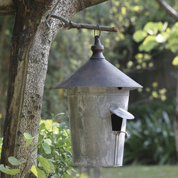 "Distressed Metal Birdhouse - Clever ""tin man"" can design offers avian accommodations complete with a flap opening and turned perch. Hangs from a round ring atop a finial."