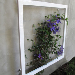 """TerraTrellis.com Ina Wall Trellis Jr. - The TerraTrellis.com Ina Wall Trellis Jr. size, 36"""" x 36"""" x 5"""" deep.  Support for ornamental or edible plants. Hand welded, sturdy steel frame, stainless steel wire, hard wearing/water resistant zero-VOC powdercoat finish or natural oxide finish, made by artists in California. Sculptural in form, practical in function. A garden structure that serves as a palette for the landscape designer or home gardener. The classic garden trellis...re-imagined."""