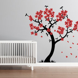 Cherry Walls - Cherry Blossom Tree Wall Decal - Raining cherry blossom petals fall sleepily from the branches, swept away by a gentle wind. This tree decal stretches up to the sky — or at least to your ceiling — with its pretty curves and lovely little flowers. It's perfect for the nursery, bedroom or anywhere you want to encourage sweet dreams.