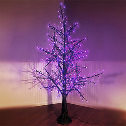 Frontgate - Black Halloween LED Tree - Outdoor Christmas Decorations - Commercial-grade lights. 250 multicolored LED lights. Black tree trunk and branches. 125V. UL listed. Make your home a haunted house with our LED 6' Black Halloween Tree. Intensely bright LED lights use less electricity than incandescent and generate very clear, crisp colors, making them especially ideal for holiday decor. Adorned with 580 glistening purple and orange lights, this creepy piece is a perfectly eerie way to instantly illuminate any ghoulish night.  .  .  .  .  . Lead cord measures 9'L .