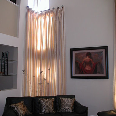 Draperies - Widely spaced pleated heading installed on decorative medallions with slouchy top.