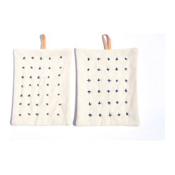 Canvas Pot Holder - Hand-stitched by Specialty Dry Goods, these canvas pot holders with leather straps are mini works of textile art.