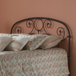 Fashion Bed Group - Grafton Headboard Only in Rusty Gold Finish - King - The prominent scrollwork on this headboard is secured in place with decorative banding. The solid castings give the headboard a playful character Not found in most iron beds. The heavy tubing creating the overall shape of the headboard display softly rounded shoulders that give historic appeal. Another elevating feature to the headboard is the finish. It carries an intricacy that may Not be Noticed at first glance. When viewed up close the finish glows with an inner warmth that warrants the name Rusty Gold, and makes it a perfect match for a warm toned bedding ensemble.