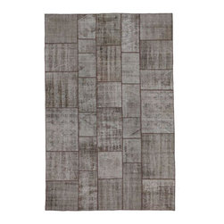 """Pre-owned Warm Taupe Overdyed Turkish Patchwork Carpet - Traditional Turkish patterns from an assortment of vintage pieces mix to make this hand made, naturally distressed vintage rug. Full cotton backing and decorative blanket stitch edging. 322    Remnants of vintage wool on a cotton warp, made entirely by hand in the '60's through '80's when Turkish women still included weaving in their daily homemaking chores. Employing the sturdy double knot technique unique to Turkish rugs, multicolor floral and medallion motifs were created a row at a time using bright hand dyed wools. Considered too old fashioned for modern Turkish homes in their traditional incarnations, these rugs have languished in back rooms of the bazaars‰Ű_until now, as these fragments in excellent condition are overdyed and combined to create modern patchwork statements for the floor.    Note from the seller: """"Our revitalization process keeps rugs that may otherwise get tossed out of landfill. Repurposed discards are helping artisans connect and create, supporting the community we're building here in Istanbul to revive vanishing traditional fiber crafts.‰Űť    Please note that all sales are final - These amazing rugs are coming direct from Istanbul, Turkey and returns will not be allowed."""
