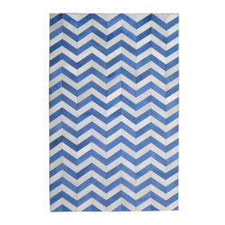 Madisons Inc. - Blue & Cream Modern Chevron Cowhide Rug, 5' X 8' - The Blue and Cream Chevron Cowhide Rug is a natural hair-on-hide area rug that has been made in India. The chevron design of natural cowhide dyed in blue with a touch of acid etching, adds a dramatic flair and striking ornamentation to any space. This rug is reserved for those who relish high design and style, as it is made by highly-skilled artisans. The cowhide has been ethically sourced in India and tenders shorter hair than those from other parts of the world as a result. Not only does this piece make a statement, but sustains the livelihood of many villages in India from which they are produced.