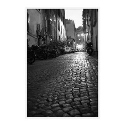 """Michal Venera Framed Print, Streets of Rome II, No Mat, 28 x 42"""", White - On first glance, these iconic images of Rome are striking for their lush sepia tones, rich detail and intriguing camera angles. A closer look reveals the beauty of patterns, whether it is hundreds of stones that make up an old street, arches in the coliseum or the remaining three columns of a ruin. All exude a sense of order and timelessness amid the ever-changing landscape of city and country. 11"""" wide x 13"""" high 16"""" wide x 20"""" high 28"""" wide x 42"""" high Alder wood frame. Black or white painted finish; or espresso stained finish. Beveled white mat is archival quality and acid-free. Available with or without a mat.{{link path='shop/accessories-decor/pb-artist-gallery/artist-gallery-michal-venera/'}}Get to know Michal Venera.{{/link}}"""