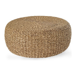 Desert Modern Woven Cocktail Table - Adding a low rattan woven cocktail table to the main living space would give the room some texture.