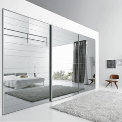 """Custom Made Closets with Sliding Doors - Exclusive closet with """"Crystal Dogato"""" sliding doors with silvered mirror finish introducing a subtle horizontal detail with decorative effect."""