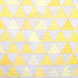 Equilateral Triangles Crib Quilt by Carson Converse Studio - This Equilateral Triangles Crib Quilt by Carson Converse is actually two quilts in one: sunny triangles on one side and lemony stripes on the other.