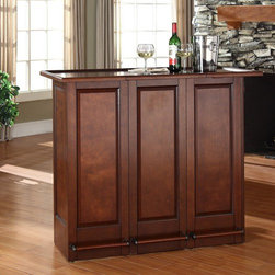 """Crosley - Mobile Folding Bar in Vintage Mahogany - Elegantly entertain guests with this mobile folding bar cabinet constructed of solid hardwood and wood veneers. The bars handsome raised panels are classically styled to enhance any home decor. The unit can be folded up to a third of its size and tucked away when you are finished entertaining, or just leave it open as a focal point in your room. Behind the bar, you will find plentiful storage space for spirits, glassware, and a host of other bar items. When open, the large 49-by-22-inch top is ideal for serving drinks or just hanging out with friends. Style, function, and quality make this mobile folding bar a wise addition to your home. Features: -Hardware finish: Antique brass. -Solid hardwood and wood veneer construction. -Sturdy foot rail with antique brass finish accents. -Hidden casters for mobility when folded up. -Open and closed storage. -Adjustable levelers for stability. -Folds up to 3"""". -When open the large top dimension: 42"""" - 49"""" H x 22"""" D. -Assembly required."""